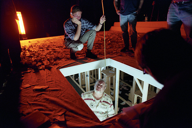 stage workers testing construction with elevator