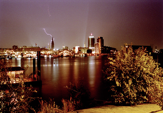 Night view over Hamburg with lightening, seen from the opposite Elbe site