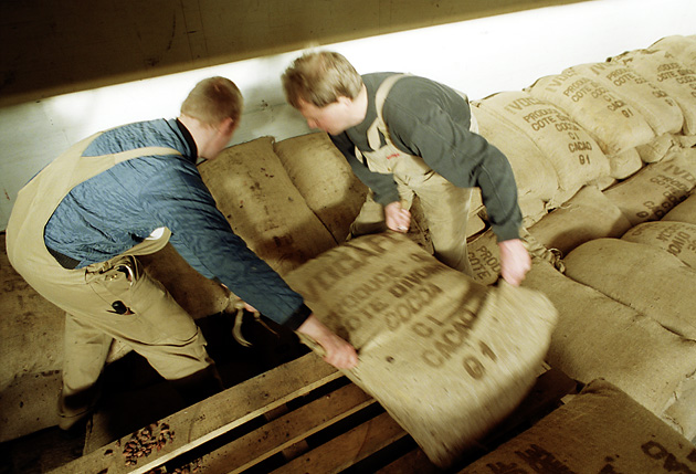 Men loading cocoa sacks at