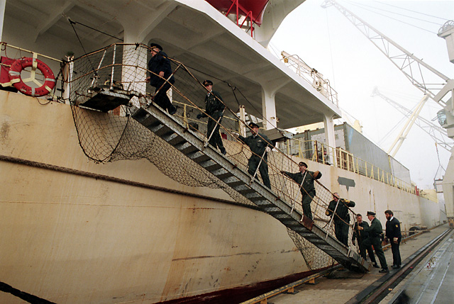 Custom officers entering ship on investigation