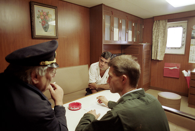 Custom officers questioning captain for possible drugs on the ship