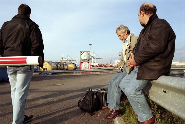 Foreign workers waiting for bus transport to their home country