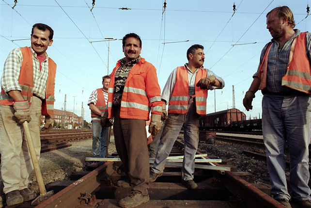 Train workers joking during work at